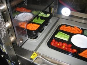 Orics vegetable tray filling and sealing machine